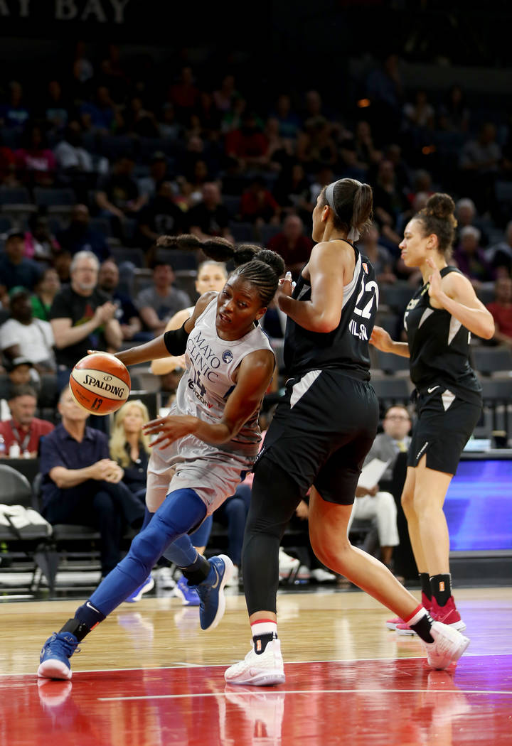 Minnesota Lynx center Temi Fagbenle (14) pushes past Las Vegas Aces A'ja Wilson (22) in the first half of a WNBA basketball game at the Mandalay Bay Events Center in Las Vegas, Sunday, June 24, 20 ...