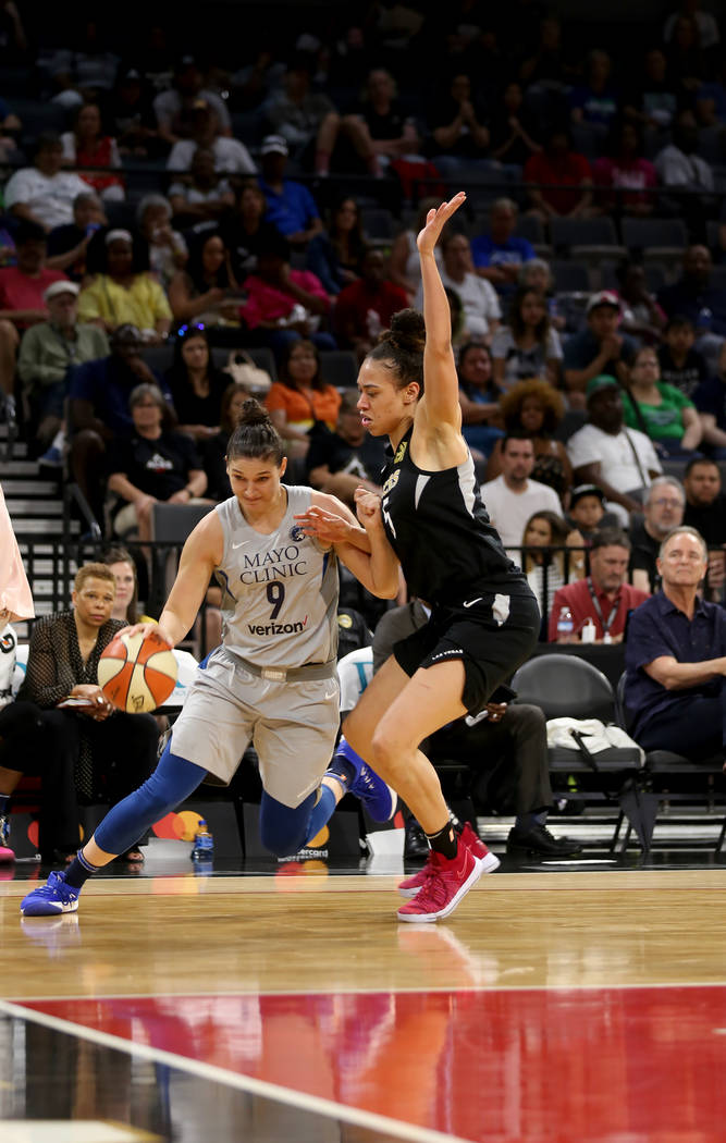 Minnesota Lynx forward Cecilia Zandalasini (9) dribbles around Las Vegas Aces forward Dearica Hamby (5) in the first half of a WNBA basketball game at the Mandalay Bay Events Center in Las Vegas, ...