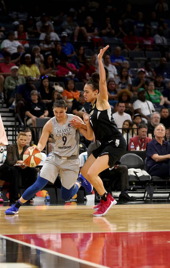 Minnesota Lynx forward Cecilia Zandalasini (9) dribbles around Las Vegas Aces forward Dearica Hamby (5) in the first half of a WNBA basketball game at the Mandalay Bay Events Center in Las Vegas, ...