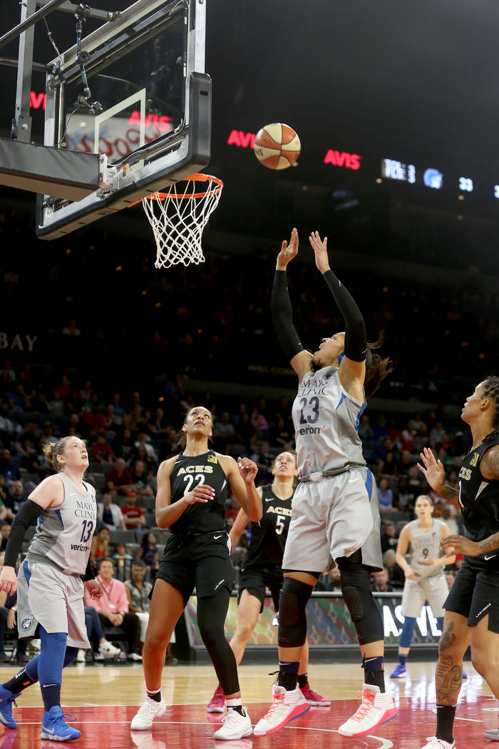 Minnesota Lynx forward Maya Moore (23) shoots to score against Las Vegas Aces center A'ja Wilson (22) in the first half of a WNBA basketball game at the Mandalay Bay Events Center in Las Vegas, Su ...