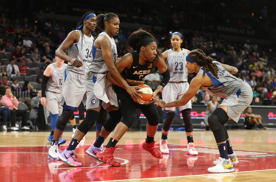 Las Vegas Aces center Kelsey Bone (3) tries to save the ball from Minnesota Lynx players center Sylvia Fowles (34), forward Rebekkah Brunson (32) and guard Seimone Augustus (33) at a WNBA basketba ...