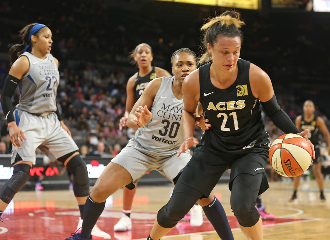 Las Vegas Aces guard Kayle McBride (21) guards the ball from Minnesota Lynx guard Tanisha Wright (30) in the second half of a WNBA basketball game at the Mandalay Bay Events Center in Las Vegas, S ...