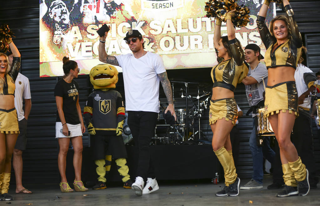 "Golden Knights left wing James Neal is introduced during the ""Stick Salute to Vegas and Our Fans"" held by the Golden Knights at the 3rd Street Stage at the Fremont Street Experience in d ..."