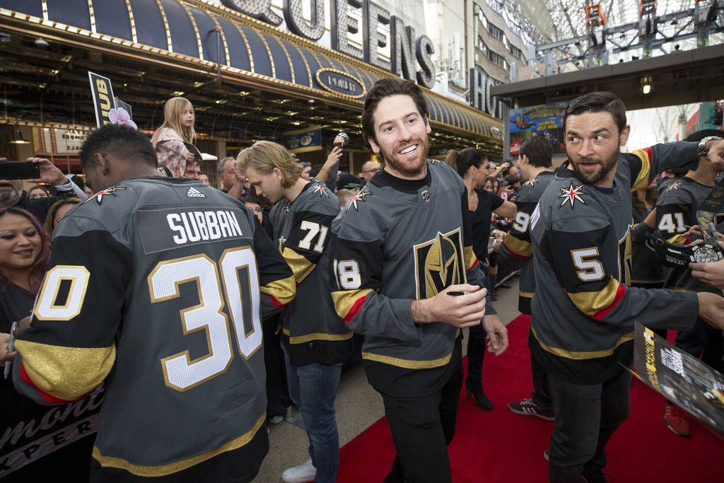 Golden Knights players Malcolm Subban (30), William Karlsson (71), James Neal (18) and Deryk Engelland (5) greet fans during the team's first fan fest at the Fremont Street Experience in downtown ...