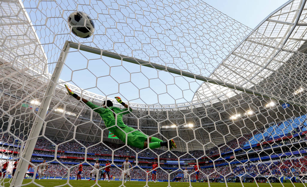 Costa Rica goalkeeper Keylor Navas fails to stop Serbia's Aleksandar Kolarov scoring the opening goal during the group E match between Costa Rica and Serbia at the 2018 soccer World Cup in the Sam ...