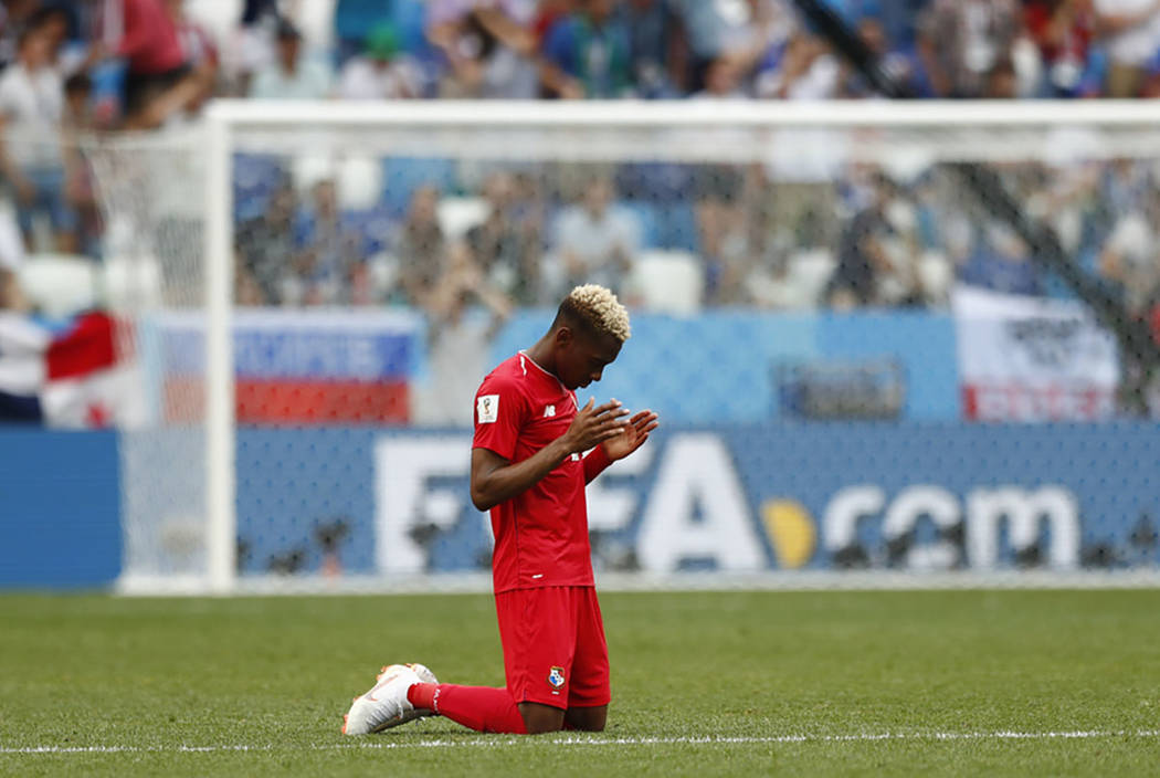 Panama's Michael Murillo kneels on the pitch following his team's 6-1 loss to England in their group G match at the 2018 soccer World Cup at the Nizhny Novgorod Stadium in Nizhny Novgorod , Russia ...