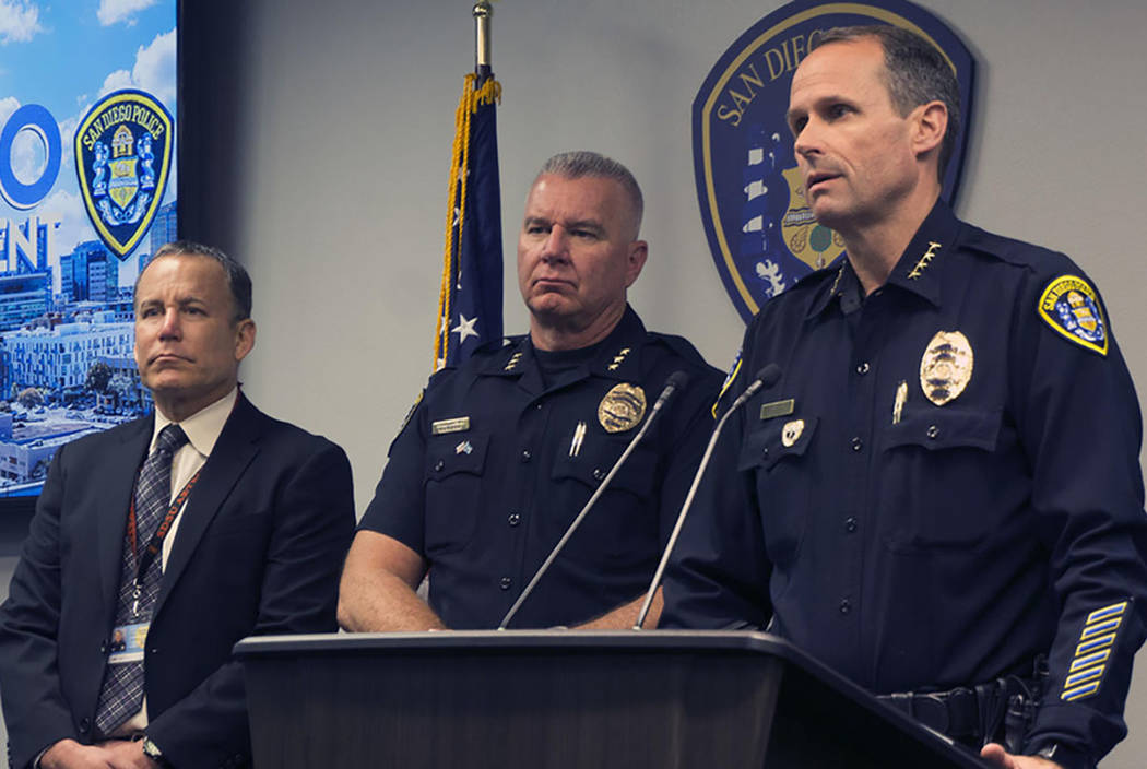San Diego Police Chief David Nisleit, right at podium, addresses the media Sunday morning, June 24, 2018, about the shooting late Saturday night that wounded two officers in San Diego, Calif. (Alm ...