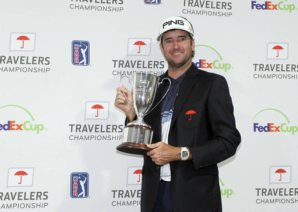 Bubba Watson poses for photos with the trophy after winning the Travelers Championship golf tournament, Sunday, June 24, 2018, in Cromwell, Conn. (AP Photo/Stew Milne)