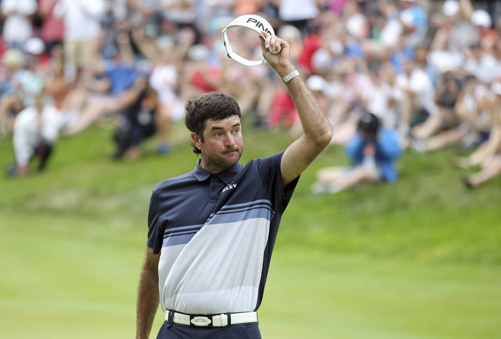 Bubba Watson tips his visor after making a birdie putt on the 18th green to win the Travelers Championship golf tournament, Sunday, June 24, 2018, in Cromwell, Conn. (AP Photo/Stew Milne)