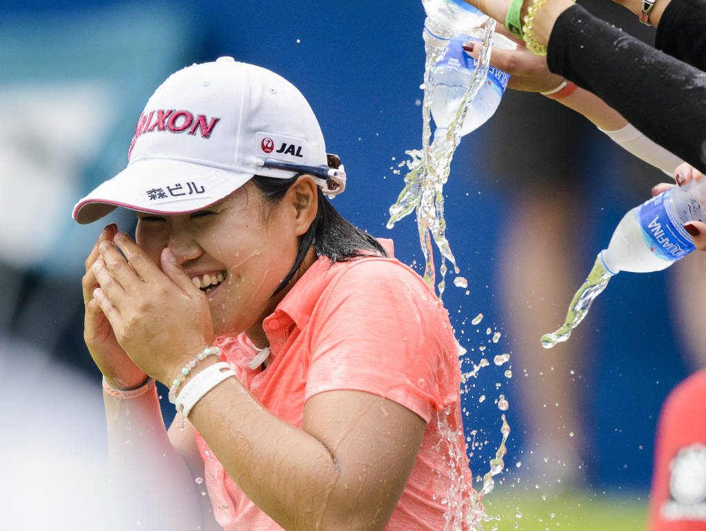 Nasa Hataoka gets doused with water after winning the NW Arkansas Championship golf tournament, Sunday, June 24, 2018, at the Pinnacle Country Club in Rogers, Ark. (Charlie Kaijo/The Northwest Ark ...