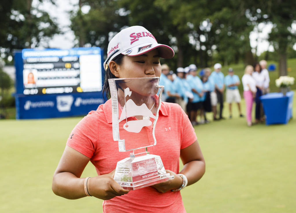 Nasa Hataoka kisses her trophy after winning the NW Arkansas Championship golf tournament, Sunday, June 24, 2018, at the Pinnacle Country Club in Rogers, Ark. (Charlie Kaijo/The Northwest Arkansas ...