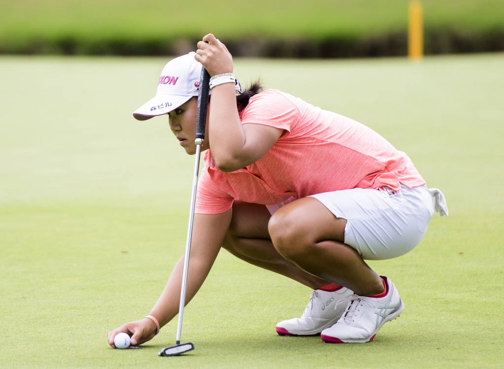 Nasa Hataoka lines up a putt during the final round of the NW Arkansas Championship golf tournament, Sunday, June 24, 2018, at the Pinnacle Country Club in Rogers, Ark. Hataoka shot an 8-under 63 ...