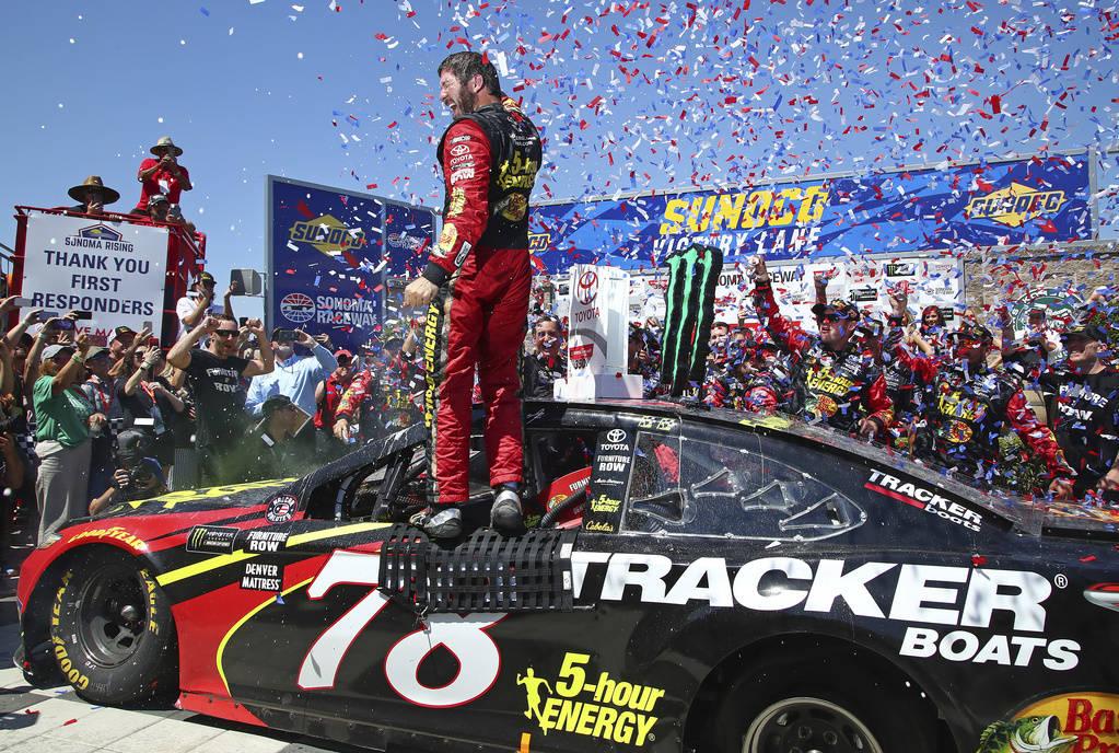 Martin Truex Jr. celebrates after winning a NASCAR Sprint Cup Series auto race Sunday, June 24, 2018, in Sonoma, Calif. (AP Photo/Ben Margot)
