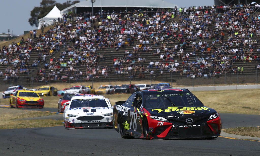 Martin Truex Jr. (78) leads Kevin Harvick (4) through a turn during a NASCAR Sprint Cup Series auto race Sunday, June 24, 2018, in Sonoma, Calif. (AP Photo/Ben Margot)