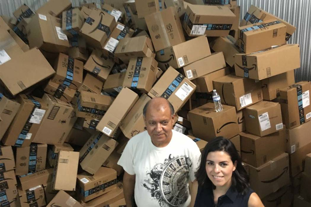 In this photograph taken June 24, 2018, Catholic Charities of the Rio Grande Valley staffer Eli Fernandez and volunteer Natalie Montelongo pose for a photo as they stand by a pile of unsorted Amaz ...
