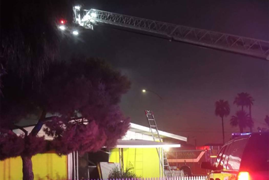 Las Vegas firefighters respond early Monday morning after a fire broke out at a vacant house at 1933 Sweeney Ave. (Max Michor/Las Vegas Review-Journal)
