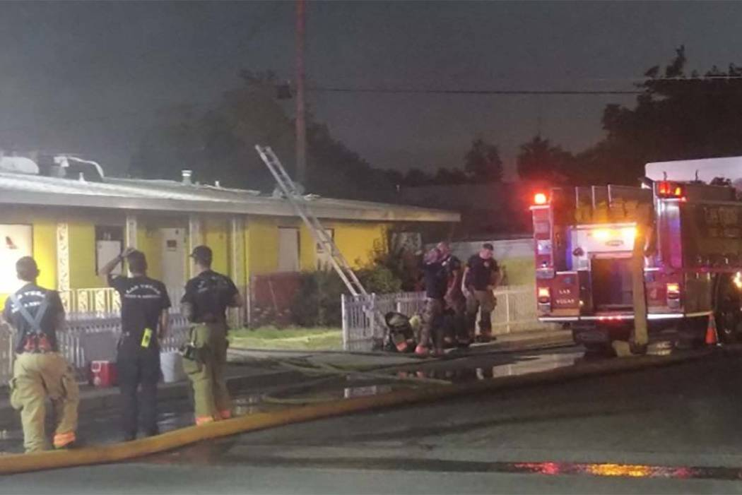 Las Vegas firefighters are assessing the situation early Monday morning after a fire broke out at a vacant house at 1933 Sweeney Ave. (Max Michor/Las Vegas Review-Journal)