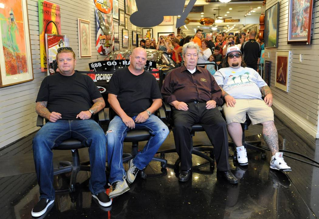 """Pawn Stars"" Corey Harrison, left, Rick Harrison, Richard ""Old Man"" Harrison and Austin ""Chumlee"" Russell at the Gold & Silver Pawn Shop in Las Vegas on Aug. 13, 2012. (Darrin Bush/Las Vegas News ..."