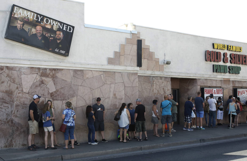 People wait in line to enter the Gold and Silver Pawn Shop in Las Vegas on Monday, June 25, 2018, in Las Vegas. Bizuayehu Tesfaye/Las Vegas Review-Journal @bizutesfaye