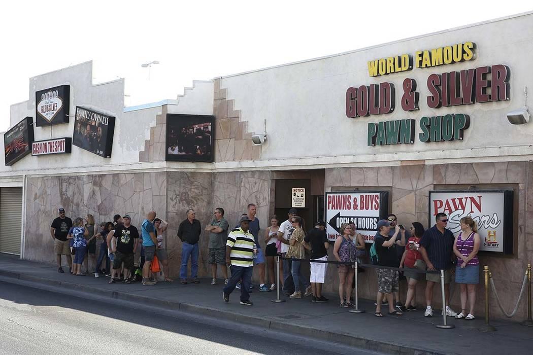 People wait in line to enter the Gold and Silver Pawn Shop in Las Vegas on Monday, June 25, 2018, in Las Vegas. Bizuayehu Tesfaye/Las Vegas Review-Journal @bizutesfaye