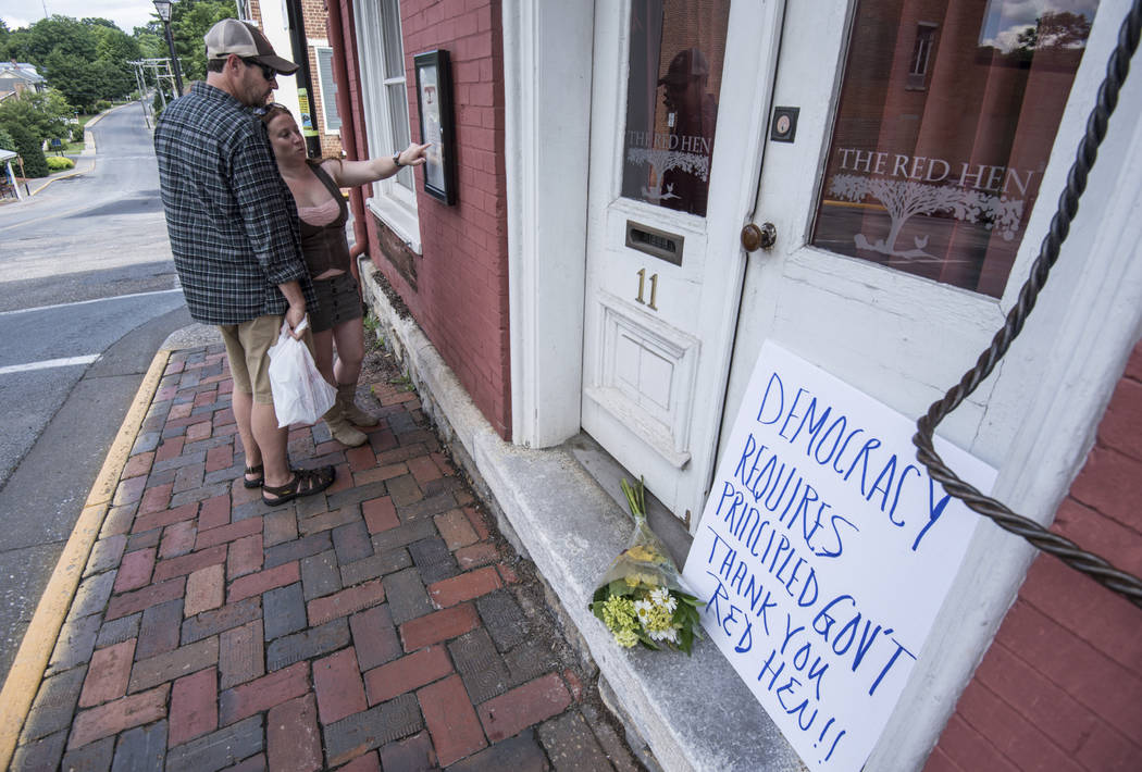 Passersby examine the menu at the Red Hen Restaurant Saturday, June 23, 2018, in Lexington, Va. White House press secretary Sarah Huckabee Sanders said Saturday in a tweet that she was booted from ...