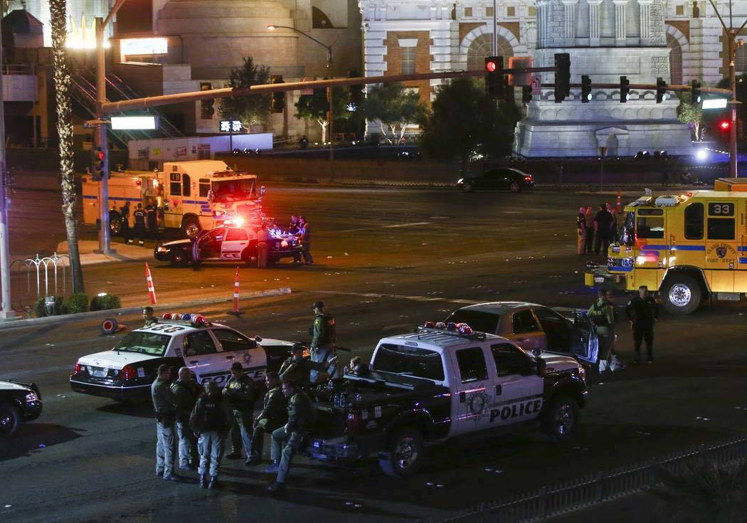 Las Vegas police gather in the early morning hours on Monday, Oct. 2, 2017, following the Route 91 Harvest festival shooting that left 58 dead on the Las Vegas Strip. Nevada will receive full reim ...