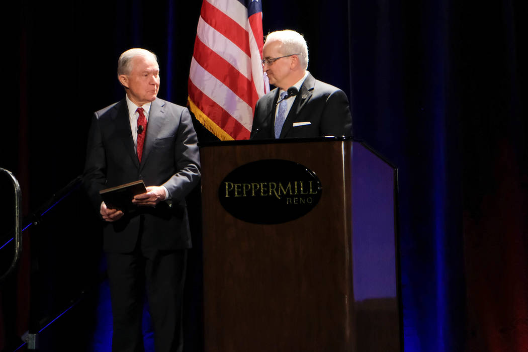 U.S. Attorney General Jeff Sessions, left, is introduced by NASRO Executive Director Mo Canady before Sessions spoke Monday at the NASRO conference in Reno. (Colton Lochhead)