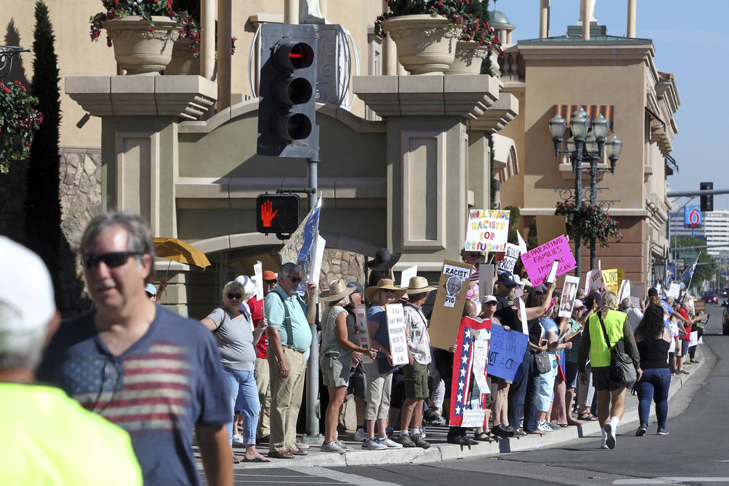Protestors demonstrate outside the Peppermill Resort-Casino in Reno as Attorney General Jeff Sessions delivers remarks on immigration to NASRO, a School Safety Conference, Monday June 25, 2018 (AP ...