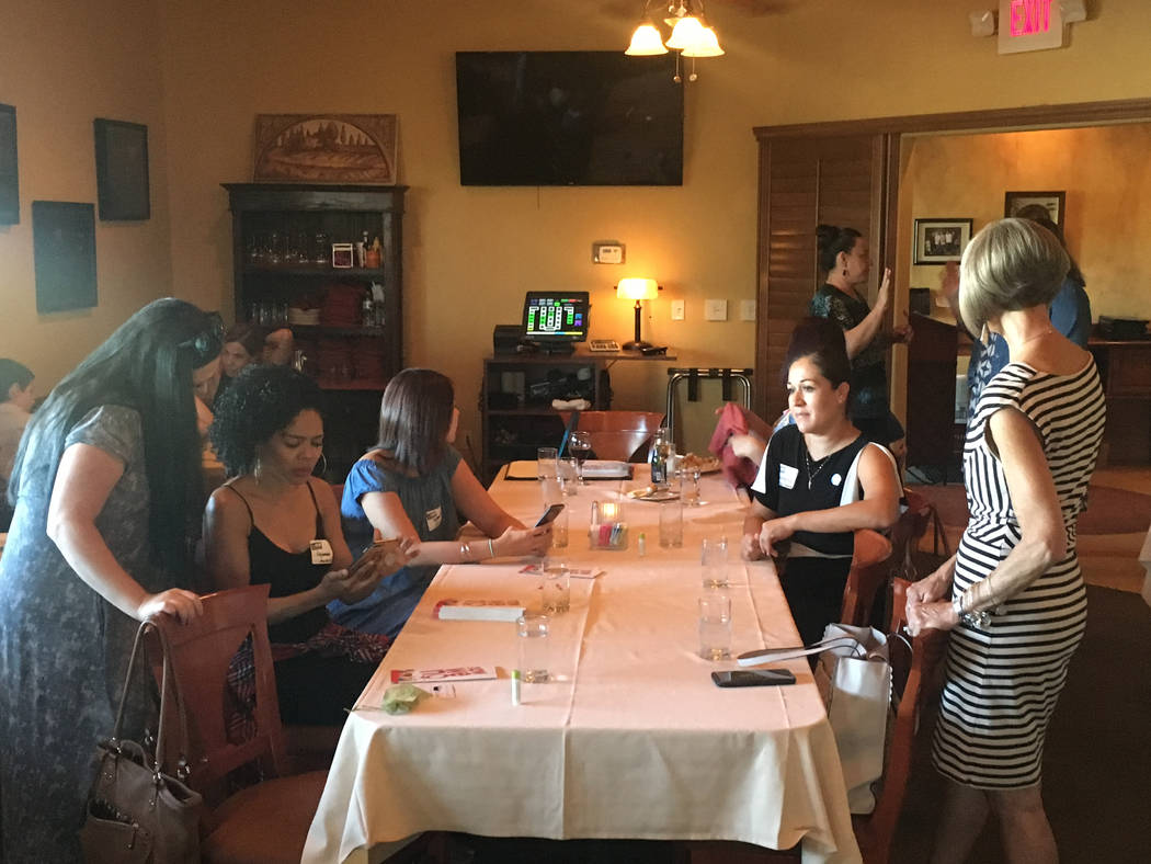 Mom business owners meet at the Henderson chapter launch at Tuscany Grill at 11105 S. Eastern Ave. on June 27. (Bailey Schulz/Las Vegas Review-Journal)