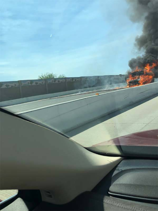 A vehicle caught fire on northbound U.S. Highway 95 near the Charleston exit in central Las Vegas, Monday, June 25, 2018. (Twitter/Dr. David C. Monroe, @APDChampion)