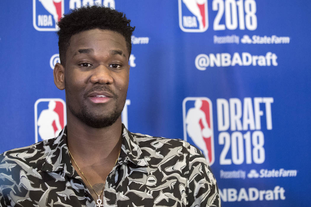 Arizona's DeAndre Ayton speaks to reporters during a media availability with the top basketball prospects in the NBA Draft, Wednesday, June 20, 2018, in New York. (AP Photo/Mary Altaffer)