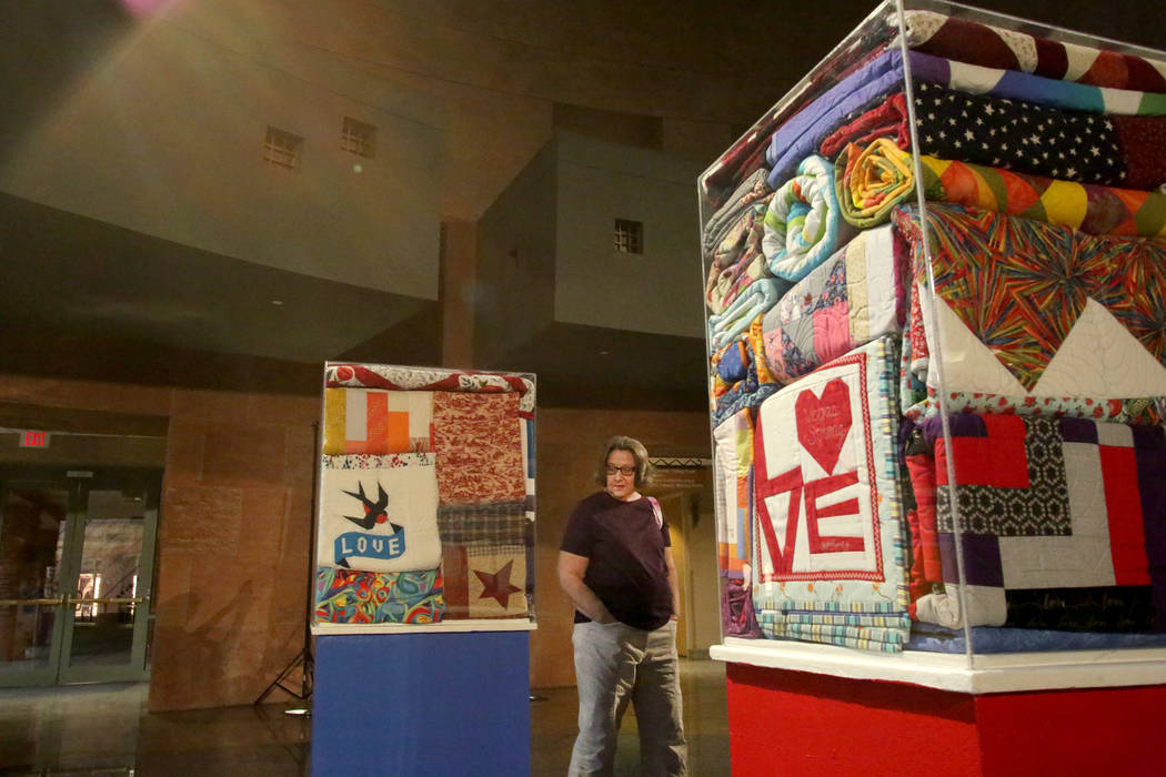 Modern Quilting Guild member Jeanne Spala admires some of the 250 quilts donated to the Vegas Strong Resiliency Center to help victims of the October 1 shooting in Las Vegas during an exhibit at t ...