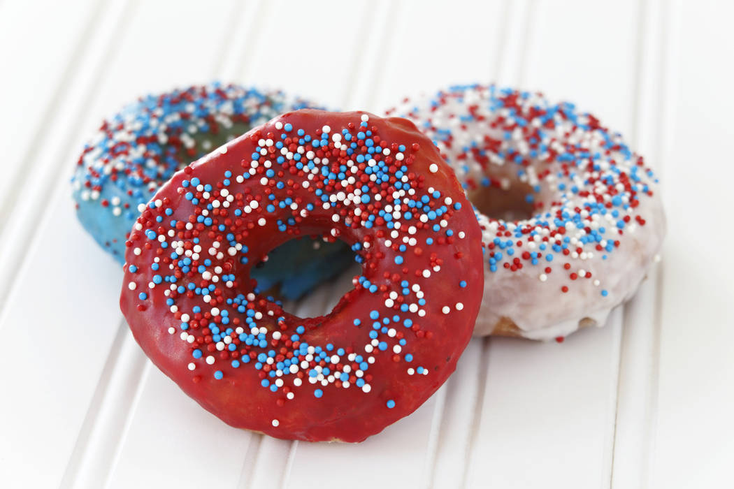 Donuts decorated with icing and sprinkles for fourth of July. Getty Images