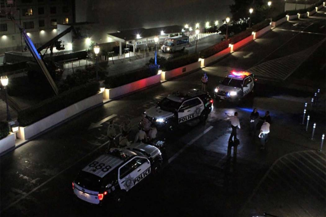 Las Vegas police investigate where a man trying to elude them jumped from the third floor of the parking garage at Bellagio. (Max Michor/Las Vegas Review-Journal)
