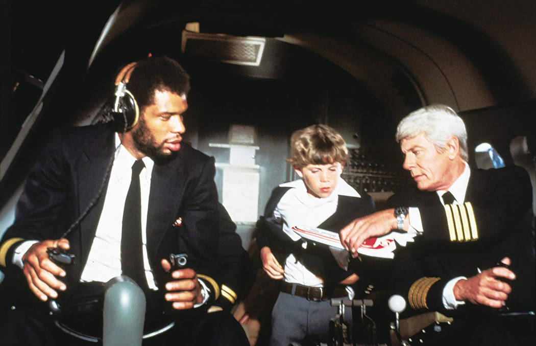 """Kareem Abdul-Jabbar, Rossie Harris and Peter Graves in """"Airplane!"""" (Paramount Pictures)"""