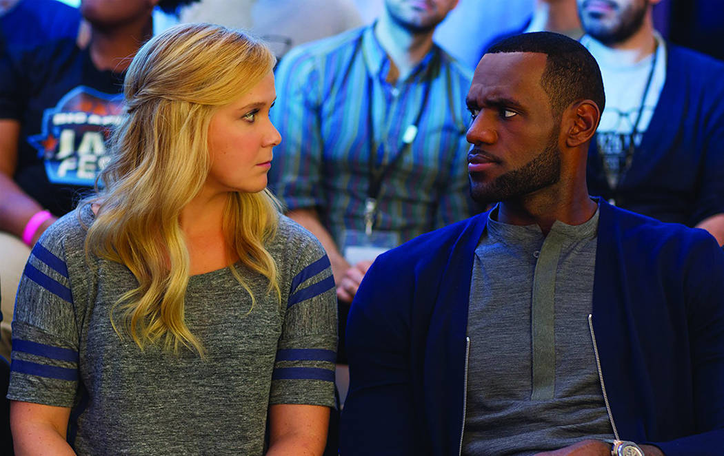 """LeBron James and Amy Schumer in a scene from """"Trainwreck."""" (Mary Cybulski/Universal Pictures)"""
