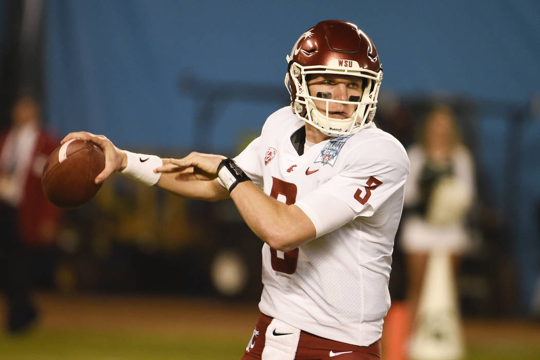 In this Dec. 28, 2017, file photo, Washington State quarterback Tyler Hilinski, throws during the first half of the Holiday Bowl NCAA college football game against Michigan State in San Diego. (AP ...