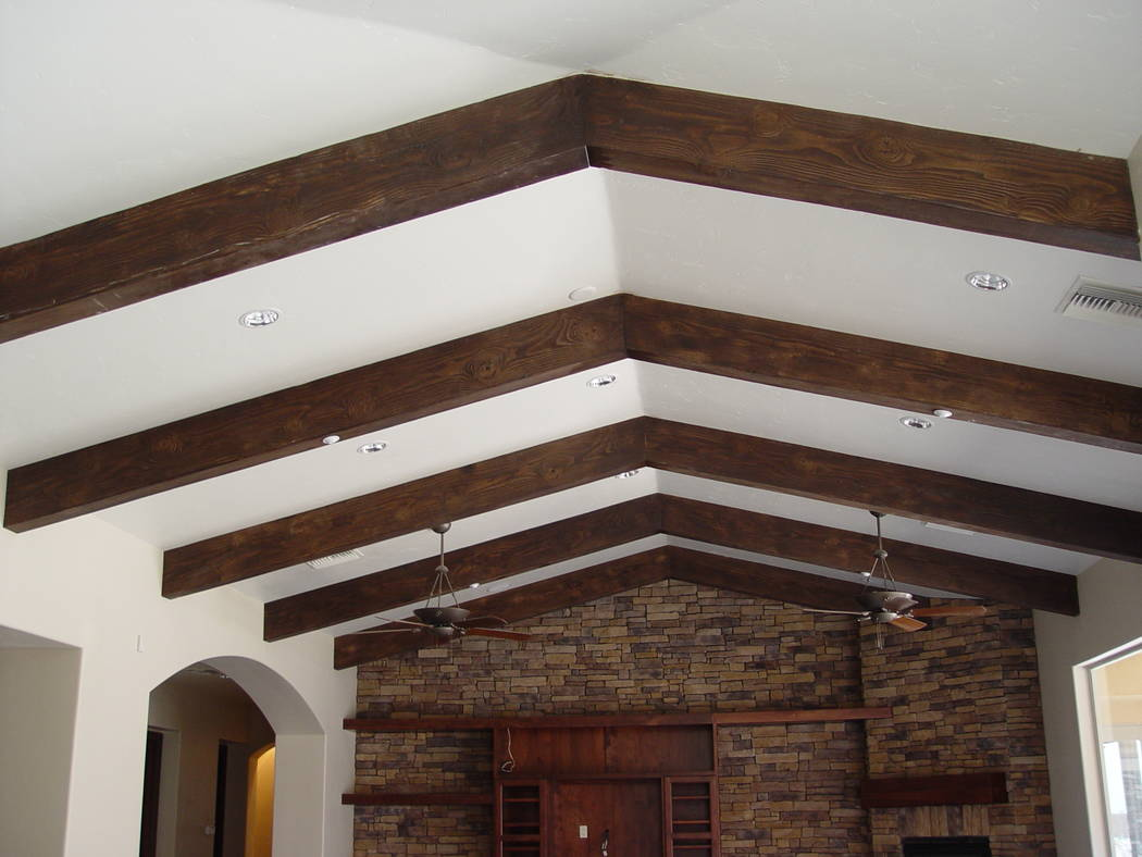 Realm of Design These architectural accents are typically added to a ceiling to add warmth and character to a room.