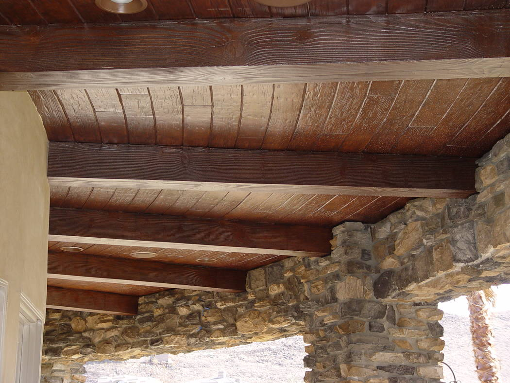 Realm of Design Since the complementary look of wood is timeless, faux wood beams can be utilized to embellish a home's exterior ceiling as well.