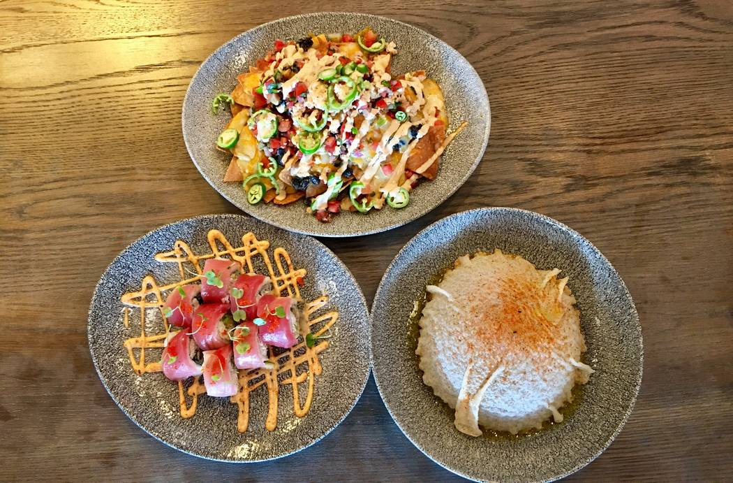 Lamplight Lounge's crab and tuna roll, front left, the tuna poke bowl, front right, and the lobster nachos, back. (Las Vegas Review-Journal)