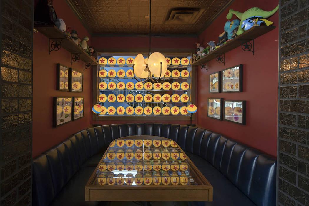 Illuminated Pixar Luxo Balls light a table inside the new Lamplight Lounge at Disney California Adventure Park. (Joshua Sudock/Disneyland Resort)