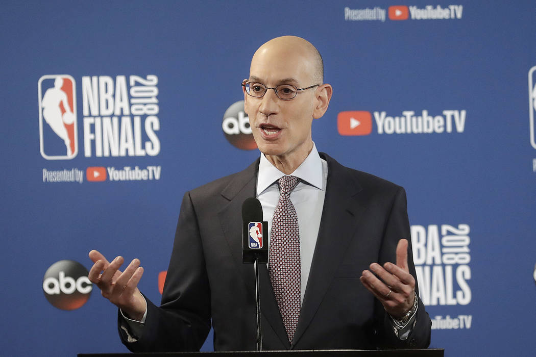 In this May 31, 2018, file photo, NBA Commissioner Adam Silver speaks at a news conference before Game 1 of basketball's NBA Finals between the Golden State Warriors and the Cleveland Cavaliers, i ...