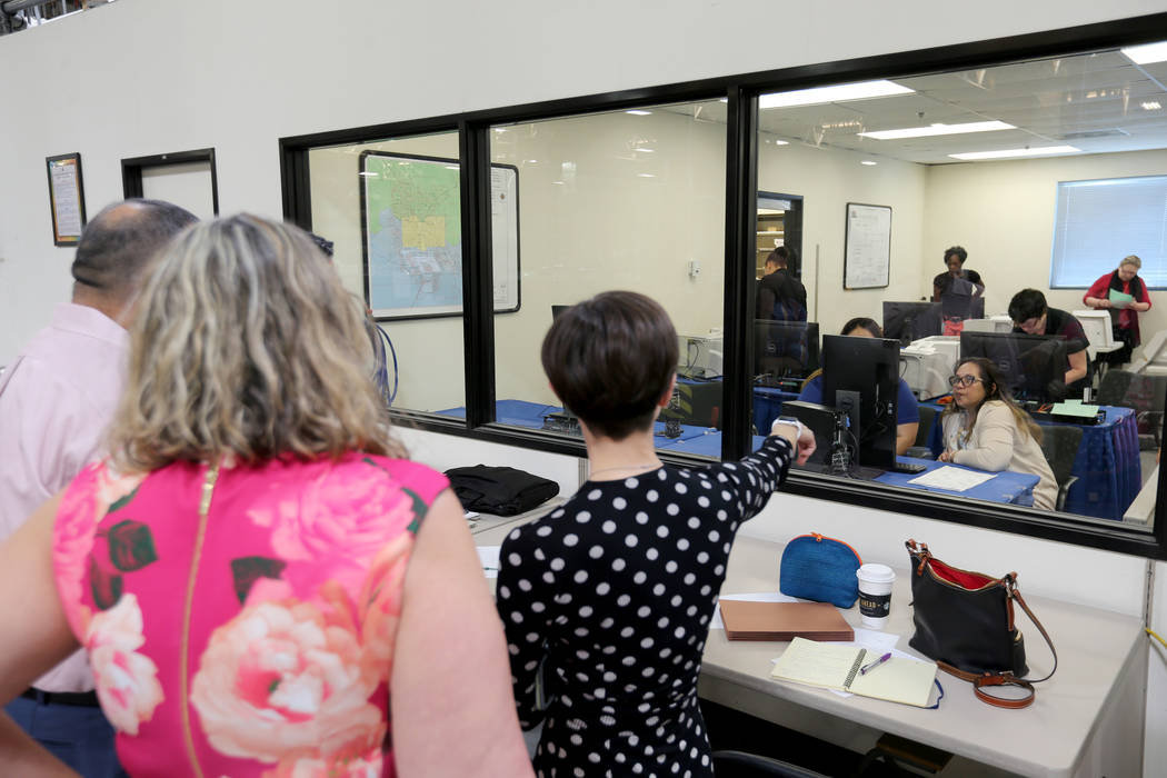 Observers watch Clark County election workers conduct a recount of the Democratic primary for the County Commission District E seat at election headquarters in Las Vegas Tuesday, June 26, 2018. K. ...