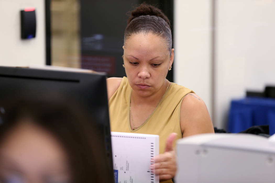 A Clark County election worker counts mail-in ballots during a recount of the Democratic primary for the County Commission District E seat at election headquarters in Las Vegas Tuesday, June 26, 2 ...
