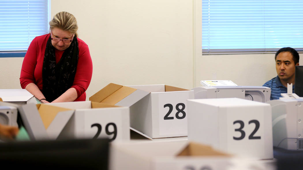 Clark County election workers count mail-in ballots during a recount of the Democratic primary for the County Commission District E seat at election headquarters in Las Vegas Tuesday, June 26, 201 ...