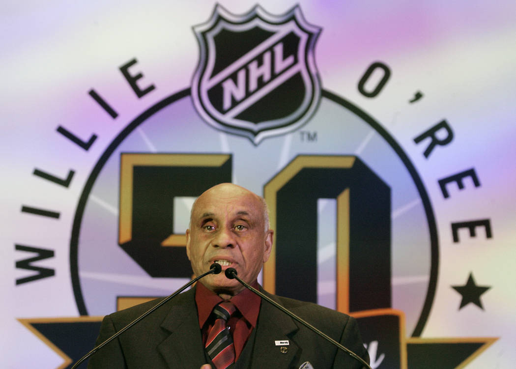 In this Jan. 25, 2008, file photo, Willie O'Ree, the first black to play in the National Hockey League, speaks during the NHL's Diversity Luncheon in Atlanta. (AP Photo/John Bazemore, File)