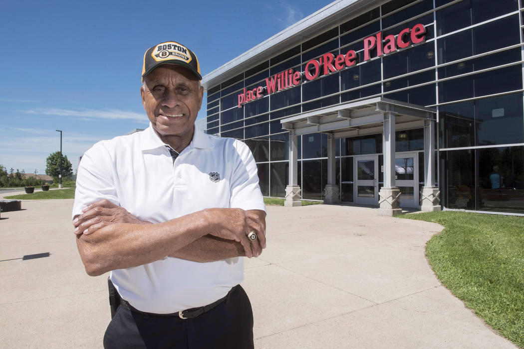 In this June 22, 2017, file photo, Willie O'Ree, known best for being the first black player in the National Hockey League, poses for a photo at the Willie O'Ree Place in Fredericton, New Brunswic ...