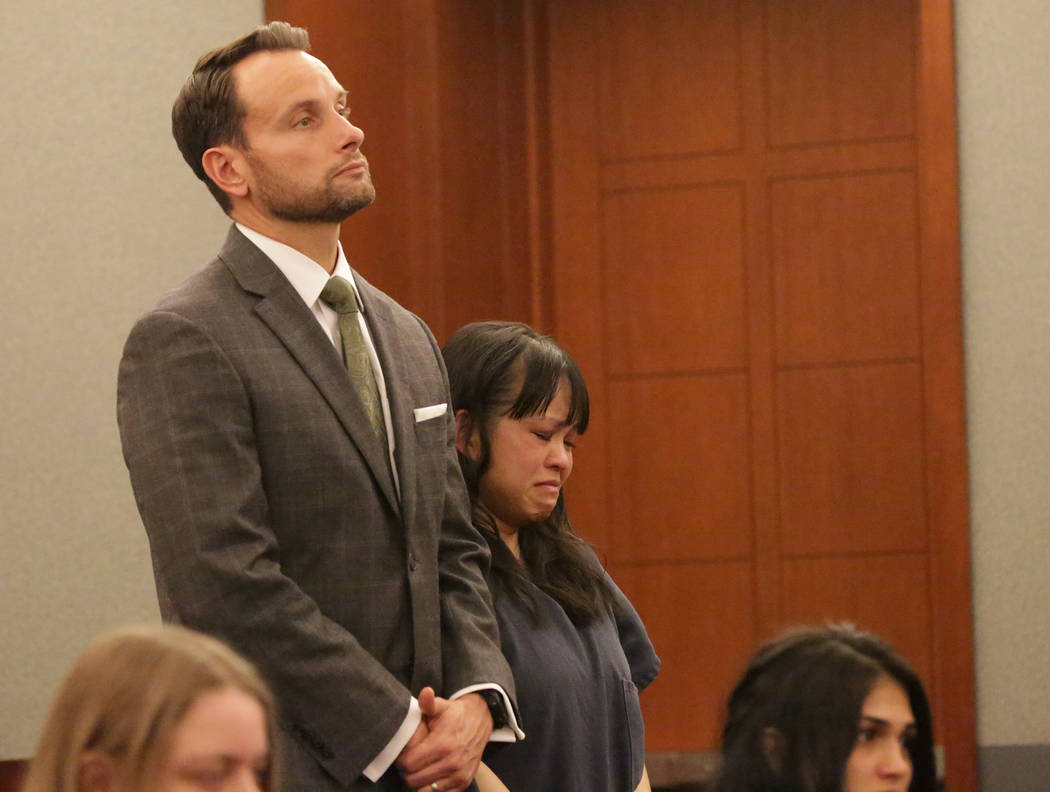 Elinor Indico, center, who was convicted of fatally stabbing her pregnant sister-in-law, stands with her attorney, Joshua L. Tomsheck, as Judge Valerie Adair sentences her to life in prison on Tue ...