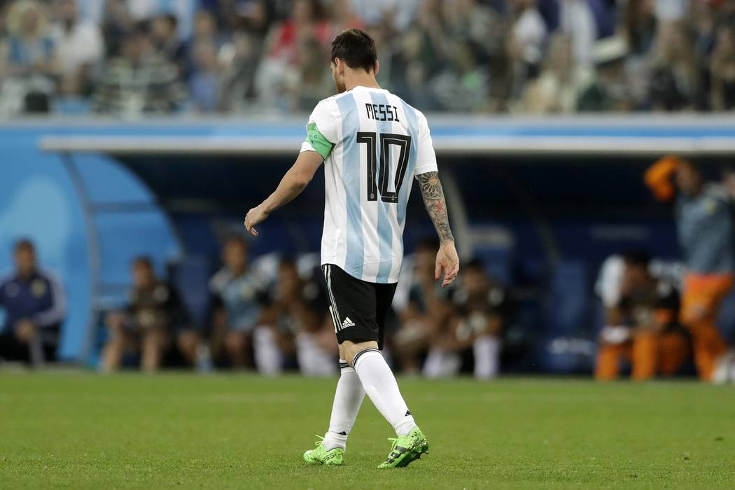 Argentina's Lionel Messi reacts after the opening goal of Nigeria during the group D match between Argentina and Nigeria, at the 2018 soccer World Cup in the St. Petersburg Stadium in St. Petersbu ...