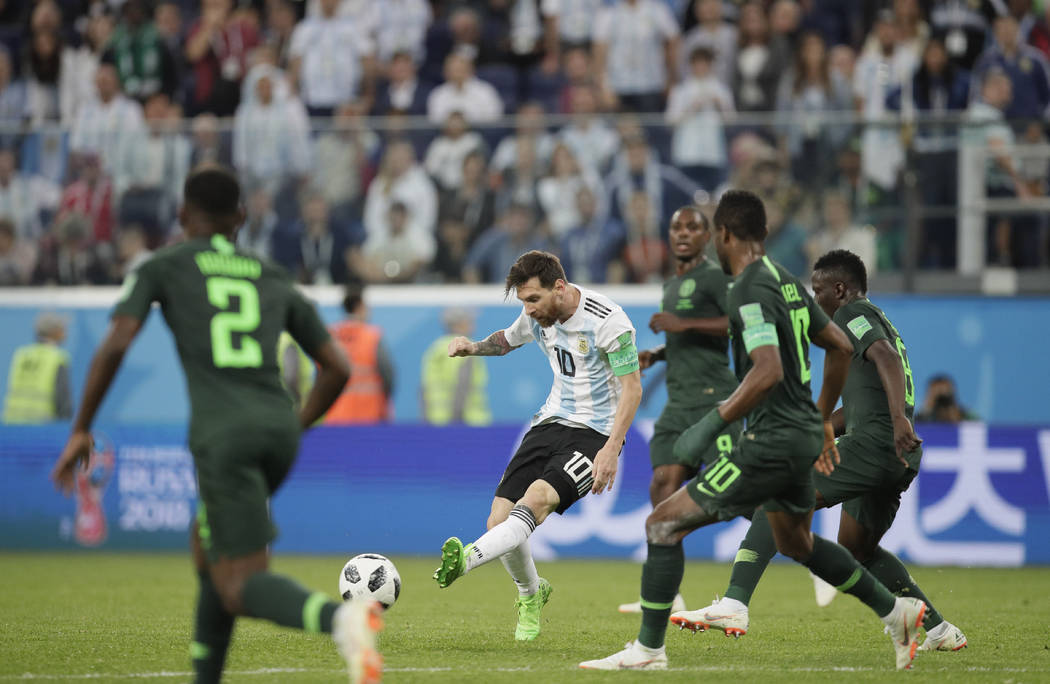 Argentina's Lionel Messi, center, kicks the ball during the group D match between Argentina and Nigeria at the 2018 soccer World Cup in the St. Petersburg Stadium in St. Petersburg, Russia, Tuesda ...